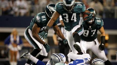Philadelphia Eagles running back Bryce Brown (34) leaps over Dallas Cowboys strong safety Danny McCray (40) during the first half of an NFL football game Sunday, Dec. 2, 2012 in Arlington, Texas. (AP Photo/Tony Gutierrez)