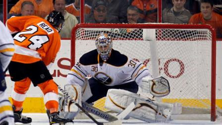 Philadelphia Flyers right wing Matt Read (24) prepares to shoot the winning goal against Buffalo Sabres goalie Ryan Miller (30) in the third period of an NHL hockey game on Thursday, April 5, 2012, in Philadelphia. The Flyers won 2-1. (AP Photo/Alex Brandon)