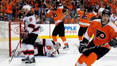 Philadelphia Flyers left wing James van Riemsdyk, right, skates away after scoring a goal as New Jersey Devils defenseman Andy Greene, left, reacts in the second period of Game 1 in a second-round NHL Stanley Cup hockey playoff series, Sunday, April 29, 2012, in Philadelphia. The Flyers won 4-3 in overtime. (AP Photo/Alex Brandon)