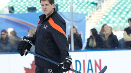Philadelphia Flyers head coach Peter Laviolette watches his team on the ice during team practice for the Winter Classic hockey game, Sunday, Jan. 1, 2012 in Philadelphia. (AP Photo/Tom Mihalek)