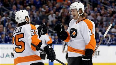 Philadelphia Flyers center Sean Couturier (14) celebrates with center Maxime Talbot (25) after scoring against the Tampa Bay Lightning during the first period of an NHL hockey game Sunday, Jan. 27, 2013, in Tampa, Fla. (AP Photo/Chris OMeara)