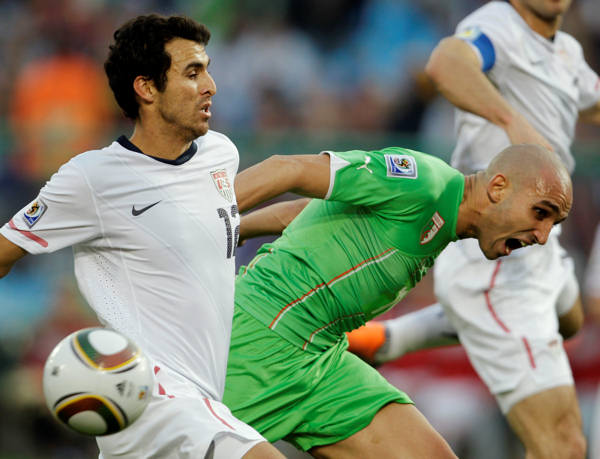 United States&#39; Jonathan Bornstein, left, competes for the ball with Algeria&#39;s Madjid Bougherra, right, during the World  Cup group C soccer match between the United States and Algeria at the Loftus Versfeld Stadium in Pretoria, South Africa, Wednesday, June 23, 2010. &#40;AP Photo&#47;Martin Mejia&#41; <span class=meta>(AP Photo&#47;Martin Mejia)</span>