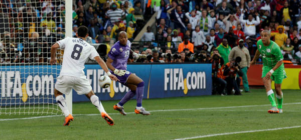 United States&#39; Clint Dempsey, left, goes to score a goal, which was later disallowed, as Algeria goalkeeper Rais M&#39;Bolhi, center, and Algeria&#39;s Madjid Bougherra, right, fail to stop him during the World Cup group C soccer match between the United States and Algeria at the Loftus Versfeld Stadium in Pretoria, South Africa, Wednesday, June 23, 2010. &#40;AP Photo&#47;Yves Logghe&#41; <span class=meta>(AP Photo&#47;Yves Logghe)</span>