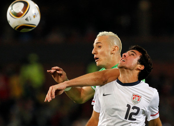 Algeria&#39;s Hassen Yebda, left, competes for the ball with United States&#39; Jonathan Bornstein, right, during the World Cup group C soccer match between the United States and Algeria at the Loftus Versfeld Stadium in Pretoria, South Africa, Wednesday, June 23, 2010. &#40;AP Photo&#47;Bernat Armangue&#41; <span class=meta>(AP Photo&#47;Bernat Armangue)</span>