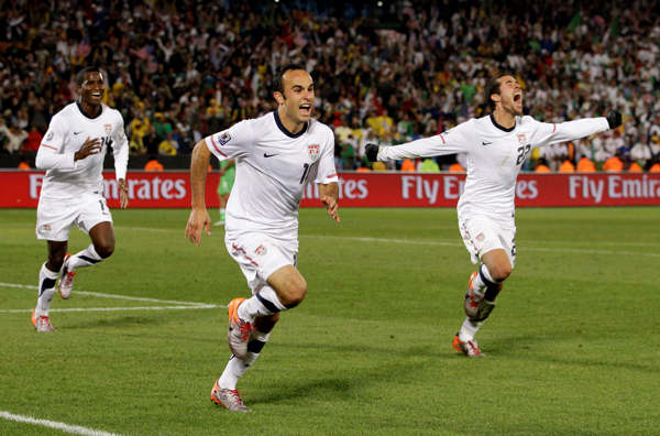 United States&#39; Landon Donovan, center, celebrates after scoring a goal with fellow team members Benny Feilhaber, right, and Edson Buddle, left, during the World Cup group C soccer match between the United States and Algeria at the Loftus Versfeld Stadium in Pretoria, South Africa, Wednesday, June 23, 2010. &#40;AP Photo&#47;Elise Amendola&#41; <span class=meta>(AP Photo&#47;Elise Amendola)</span>