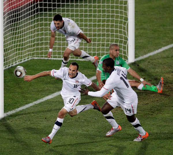 United States&#39; Landon Donovan, front left, celebrates after scoring a goal with fellow team members United States&#39; Clint Dempsey, back left, and United States&#39; Edson Buddle, front right, during the World Cup group C soccer match between the United States and Algeria at the Loftus Versfeld Stadium in Pretoria, South Africa, Wednesday, June 23, 2010. &#40;AP Photo&#47;Michael Sohn&#41; <span class=meta>(AP Photo&#47;Michael Sohn)</span>