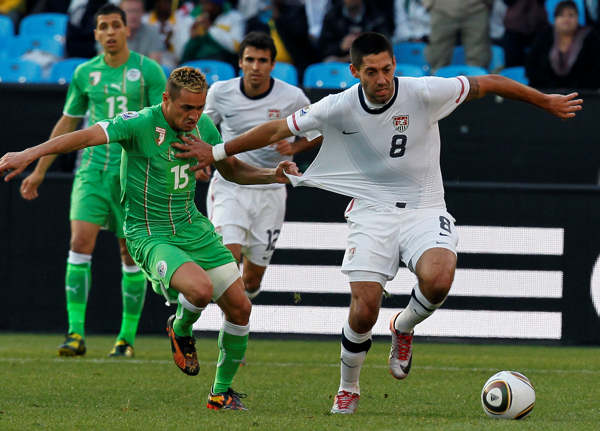 Algeria&#39;s Karim Ziani, left, grabs United States&#39; Clint Dempsey&#39;s jersey during the World Cup group C soccer match between the United States and Algeria at the Loftus Versfeld Stadium in Pretoria, South Africa, Wednesday, June 23, 2010. &#40;AP Photo&#47;Eugene Hoshiko&#41; <span class=meta>(AP Photo&#47;Eugene Hoshiko)</span>
