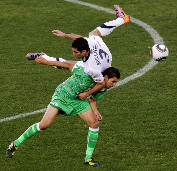 Algeria&#39;s Karim Matmour, bottom, tangles with United States&#39; Carlos Bocanegra, top, during the World Cup group C soccer match between the United States and Algeria at the Loftus Versfeld Stadium in Pretoria, South Africa, Wednesday, June 23, 2010. &#40;AP Photo&#47;Michael Sohn&#41; <span class=meta>(AP Photo&#47;Michael Sohn)</span>
