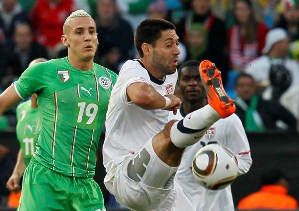 "<div class=""meta image-caption""><div class=""origin-logo origin-image ""><span></span></div><span class=""caption-text"">Algeria's Hassen Yebda, left, and United States' Clint Dempsey go for the ball during the World Cup  group C soccer match between the United States and Algeria at the Loftus Versfeld Stadium in Pretoria, South Africa, Wednesday, June 23, 2010. (AP Photo/Eugene Hoshiko) (AP Photo/Eugene Hoshiko)</span></div>"