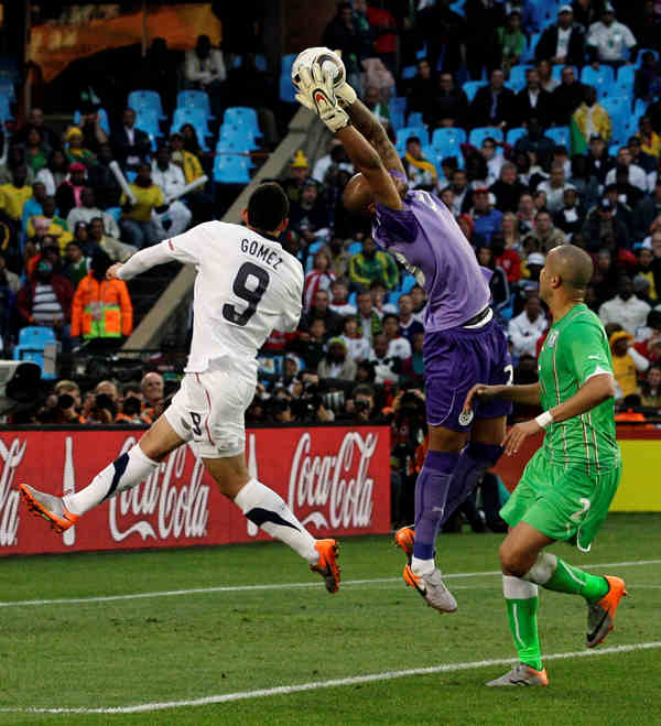 United States&#39; Herculez Gomez, left, tries to score as Algeria goalkeeper Rais M&#39;Bolhi, center, catches the ball during the World Cup group C soccer match between the United States and Algeria at the Loftus Versfeld Stadium in Pretoria, South Africa, Wednesday, June 23, 2010. At right is Algeria&#39;s Madjid Bougherra. &#40;AP Photo&#47;Yves Logghe&#41; <span class=meta>(AP Photo&#47;Yves Logghe)</span>