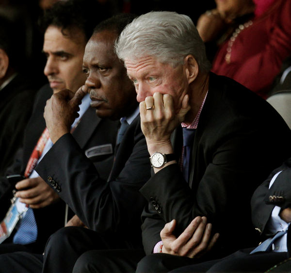 Former U.S. President Bill Clinton, right, watches the World  Cup group C soccer match between the United States and Algeria at the Loftus Versfeld Stadium in Pretoria, South Africa, Wednesday, June 23, 2010. &#40;AP Photo&#47;Michael Sohn&#41; <span class=meta>(AP Photo&#47;Michael Sohn)</span>