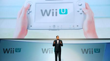 Reggie Fils-Aime, President of Nintendo of America, introduces their new gaming console the Wii U during a news conference at the E3 Gaming Convention in Los Angeles, Tuesday, June 7, 2011. (AP Photo/Chris Pizzello)