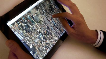 The new Apple Maps application is demonstrated in New York on Thursday, Sept. 20, 2012. Apple released an update to its iPhone and iPad operating system on Wednesday that replaces Google Maps with Apples own application. Early upgraders are reporting that the new maps are less detailed, look weird and misplace landmarks. Its shaping up to be a rare setback for Apple. (AP Photo/Karly Domb Sadof)
