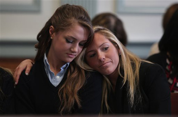 High school senior Rachel Canning, left, is comforted by friend Lauren Inglesino after seeing her father in Morris County Superior Court in Morristown, N.J., Tuesday, March 4, 2014. <span class=meta>(&#40;AP Photo&#47;Daily Record, Bob Karp, Pool&#41;)</span>