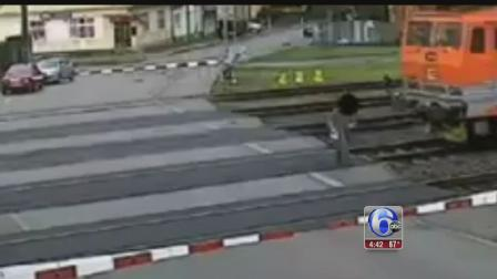 Pedestrian inches away from being hit by train