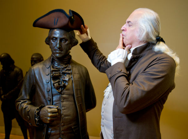 George Washington has some fun with the bronze statue of himself inside Signers? Hall at the National Constitution Center <span class=meta>(All photos courtesy of Jeff Fusco)</span>