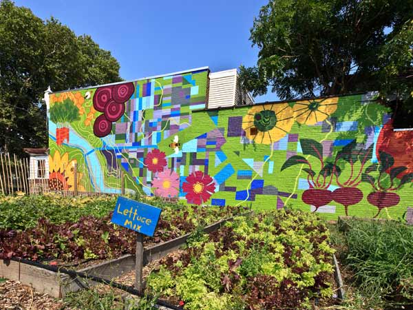 "<div class=""meta ""><span class=""caption-text "">The Abundant City © 2012 City of Philadelphia Mural Arts Program / Eurhi Jones. This mural at the New Growth Project at Marathon Farm accompanies structures built by members of Mural Arts' Restorative Justice Program.  (Photo by Steve Weinik)</span></div>"