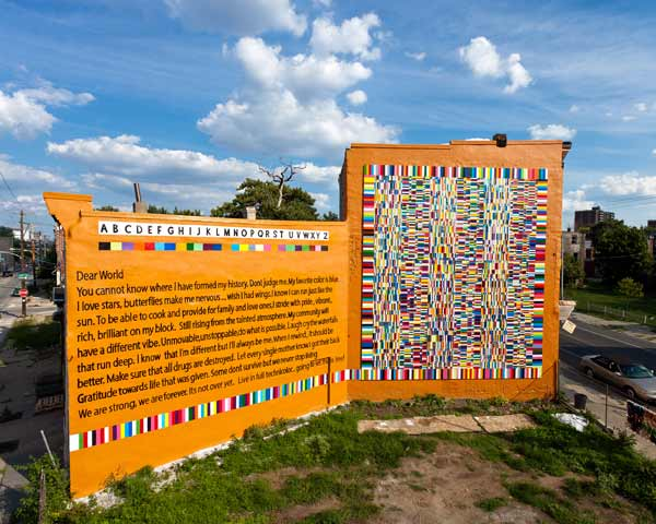 "<div class=""meta ""><span class=""caption-text "">The Color of Your Voice © 2012 City of Philadelphia Mural Arts Program / Keir Johnston, Ernel Martinez, Nina ""Lyrispect"" Ball. This coded mural about strength and resilience features a poem created by community members and represents a partnership between Mural Arts' Porch Light Initiative, Project H.O.M.E. and their service recipients.  (Photo by Steve Weinik)</span></div>"