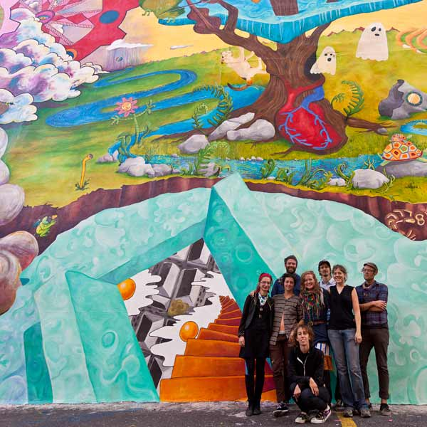 How to Turn Anything Into Something Else &copy; 2011 City of Philadelphia Mural Arts Program &#47; Miss Rockaway Armada. Members of the Miss Rockaway Armada collective pose for a photo at the mural dedication.  <span class=meta>(Photo by Steve Weinik)</span>