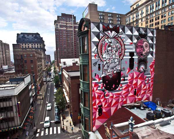 Personal Melody &copy; 2012 City of Philadelphia Mural Arts Program &#47; How and Nosm. The mural, by twin brothers and former graffiti writers, How and Nosm &#40;born in Spain, raised in Germany&#41; depicts falling bombs and other whimsical images in shades of grey, pink, and red.  <span class=meta>(Photo by Steve Weinik)</span>