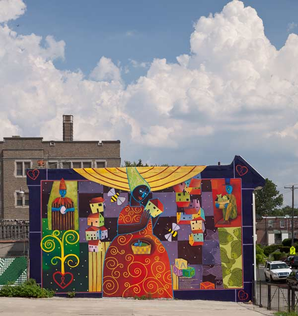 Universal Principle of a Mother&#39;s Love &copy; 2012 City of Philadelphia Mural Arts Program &#47; Parris Stancell. This vibrant work of art appears on the wall of the Maternity Care Coalition, and depicts a young mother and her thoughts about the future for her child.  <span class=meta>(Photo by Jack Ramsdale)</span>