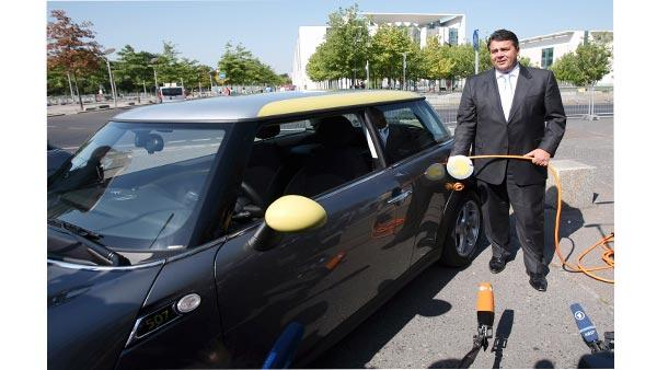 German Environment Minister Sigmar Gabriel poses for the media with a Mini electric automobile in Berlin, Germany, Wednesday, Aug. 19, 2009. Germany launched a campaign Wednesday to put 1 million electric cars on the road by 2020, making battery research a priority as it tries to position the country as a market leader. (AP Photo/Maya Hitij)