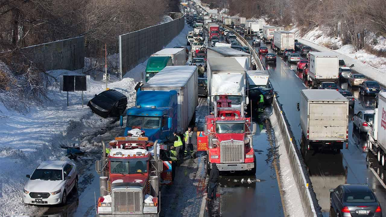 Vehicles are piled up in an accident Friday, Feb. 14, 2014, in Bensalem, Pa. Traffic accidents involving multiple tractor trailers and dozens of cars have completely blocked one side of the Pennsylvania Turnpike outside Philadelphia and caused some injuries.  <span class=meta>(AP Photo&#47;Matt Rourke)</span>