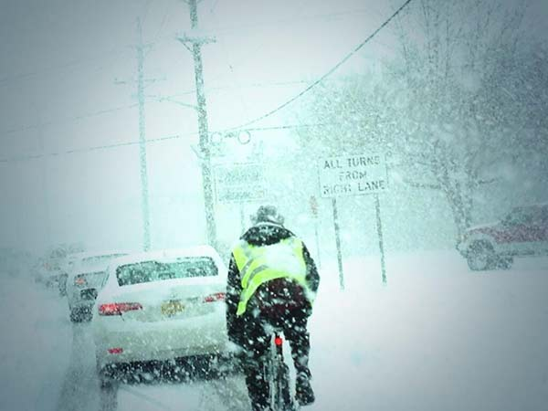 (@Xenagate) send this via Twitter: This guy is getting further than we are!  He is riding his bike on Route 73 in Pennsauken in the snow
