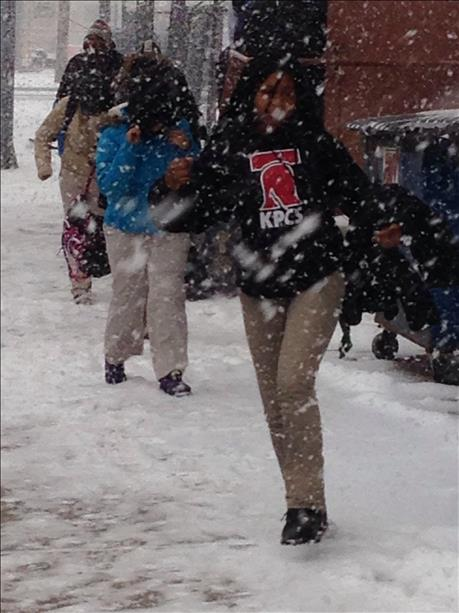 Students from KIPP charter school make their way home after early dismissal.
