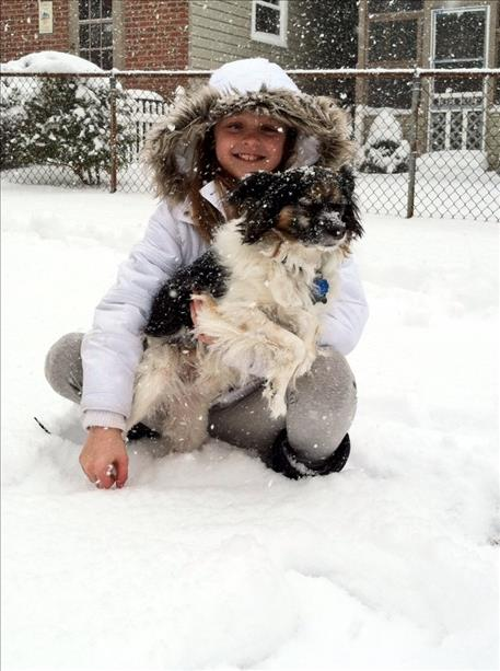 "<div class=""meta ""><span class=""caption-text "">Laci and Max playing in the snow.</span></div>"