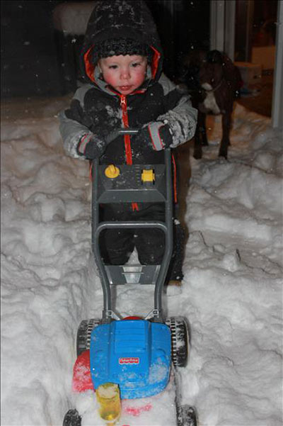 "<div class=""meta ""><span class=""caption-text "">Finnegan mowing the snow</span></div>"