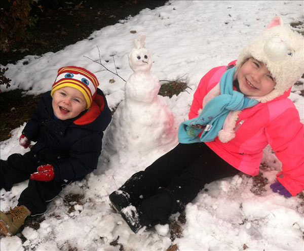 Josh, Ava and their snowman!
