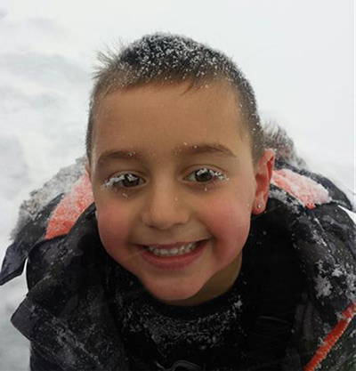 Giovanni is all smiles playing in the snow with his snow covered eyes!