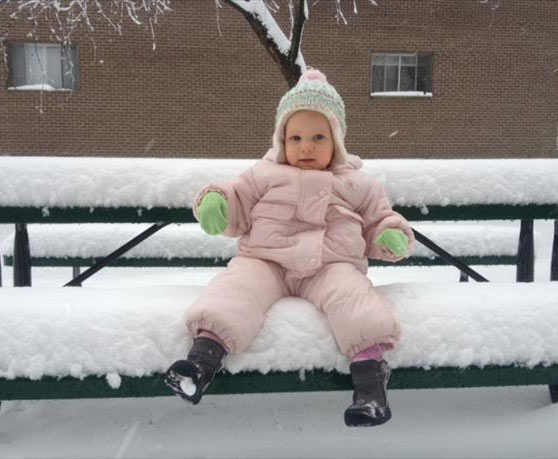 Lylah sitting on about 6 inches of snow in Roxborough