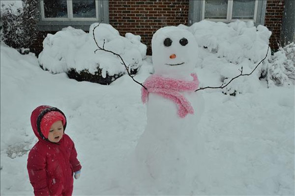 Brianna just got finished building her first snowman.