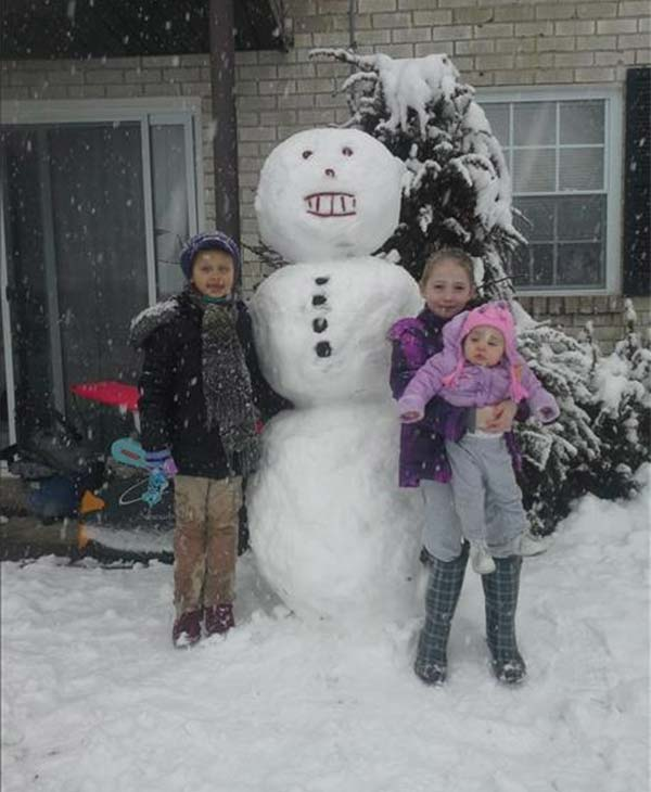 Ava, Laitlyn and Kylie in Southampton, Pa. with their snowman.
