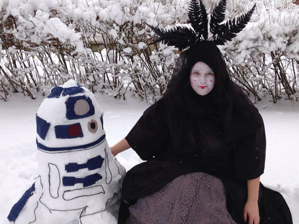 Viewer Photo from February 3rd snowstorm: My creative niece, Shelby VanValkenburgh, decided to make an R2D2 from Monday's snow and dress up in character in Pennsburg, Pa. - Judy Schimpf