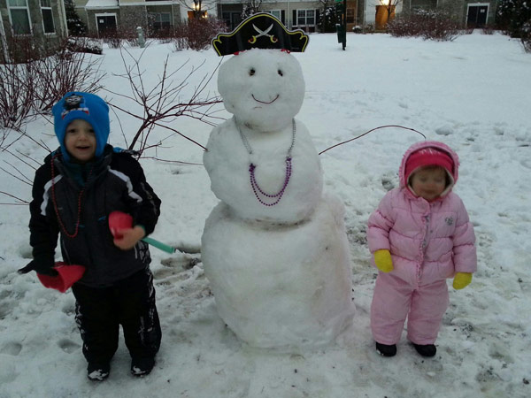 Viewer Photo from February 3rd snowstorm: Our two adorable grand-kids and their pirate snowman enjoying the day in Mt. Laurel, N J. from Jenn (Mom)