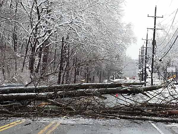 In the left of the frame, you can make out a car under the tree and power lines along  Route 322 in Downingtown, Pa. during Wednesday morning's ice storm.  From Tom Colligan
