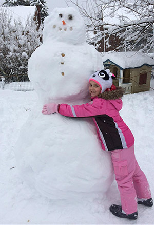 McKenzie from Reading, Pa. poses with her new snowman friend.