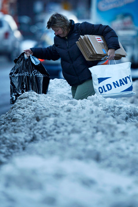 TOP 5 SNOWIEST WINTERS IN PHILADELPHIA     #1: 2009-2010; 78.7 inches    A person with bags in hand negotiates snow piled high in the aftermath of a storm in Philadelphia, Monday, Dec. 21, 2009. (AP Photo/Matt Rourke)