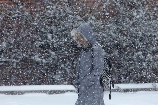 "<div class=""meta ""><span class=""caption-text "">TOP 5 SNOWIEST WINTERS IN PHILADELPHIA     #3: 2013-2014; 59.5 inches and counting...   A pedestrian walks through a snow storm, Tuesday, Jan. 21, 2014, in south Philadelphia.  (AP Photo/Matt Slocum)         </span></div>"