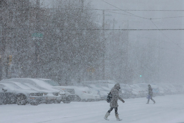 TOP 5 SNOWIEST WINTERS IN PHILADELPHIA     #3: 2013-2014; 59.5 inches and counting...   Pedestrians walk through a snow storm, Tuesday, Jan. 21, 2014, in south Philadelphia. . (AP Photo/Matt Slocum)