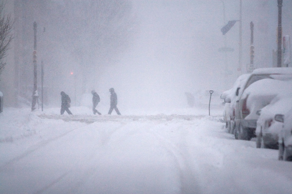 TOP 5 SNOWIEST WINTERS IN PHILADELPHIA     #1: 2009-2010; 78.7 inches    People walk along a snow covered street during a winter storm, Saturday, Feb. 6, 2010, in Philadelphia. (AP Photo/Jessica Kourkounis)