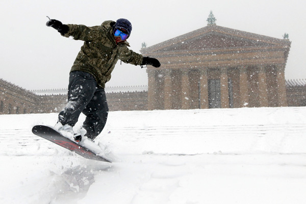 TOP 5 SNOWIEST WINTERS IN PHILADELPHIA     #1: 2009-2010; 78.7 inches    Mike Nagao snowboards down the snow-covered steps of the Philadelphia Museum of Art during a winter storm in Philadelphia, Saturday, Feb. 6, 2010. (AP Photo/Matt Rourke)
