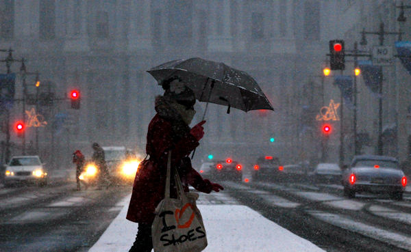 A person crosses Broad Street during a winter storm, Sunday, Dec. 26, 2010, in Philadelphia. (AP Photo/Matt Slocum)