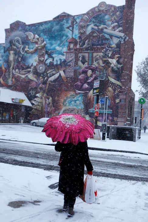 "<div class=""meta ""><span class=""caption-text "">A woman walks along Broad Street during a winter storm, Sunday, Dec. 26, 2010, in Philadelphia. (AP Photo/Matt Slocum)</span></div>"