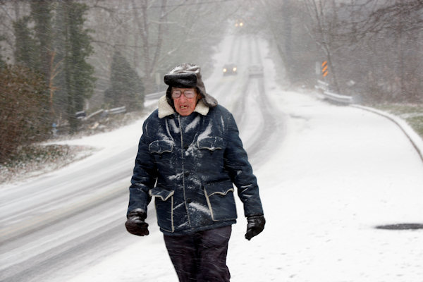 Roland Lippincott, 92, walks in a snow fall along a rural road near Yardley, Pa., Sunday, Dec. 26, 2010. (AP Photo/Mel Evans)