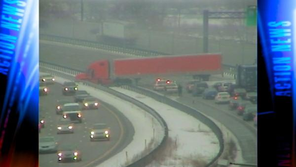 Traffic is jammed on the I-95 inner lanes near the Philadelphia International Airport because of a tractor trailer that ended up straddling the highway. Drivers are being forced onto the outer lanes.