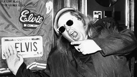 FILE - In this June 10, 1988 file photo, comedian Sam Kinison, known for his bellowed outbursts, poses at New Yorks Hard Rock Cafe where he was filming a promo for MTV.